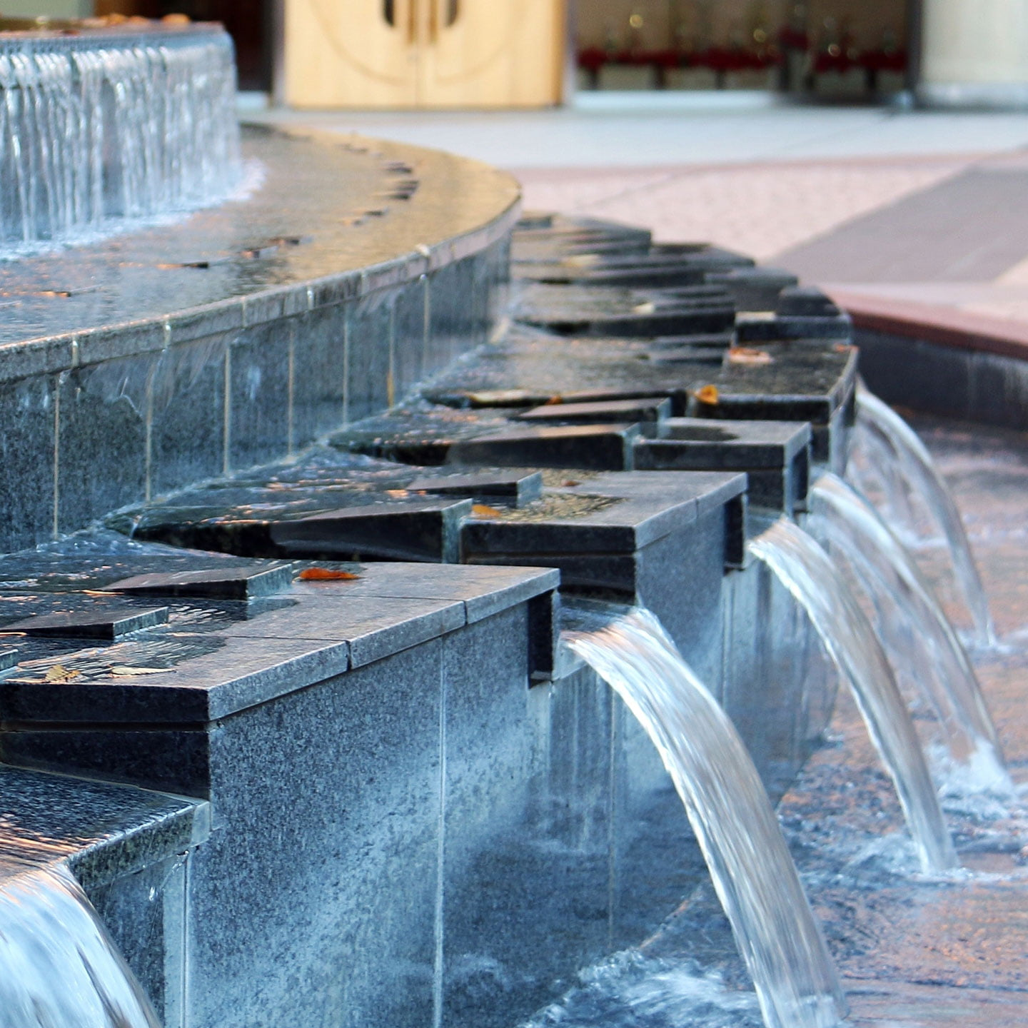 Photo of an indoor water fountain made from marble