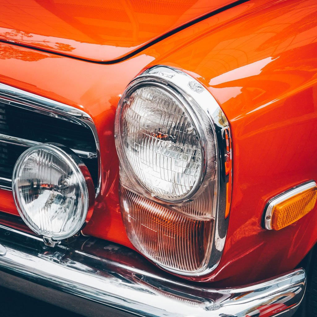Macro photo of an orange automobile chasis.
